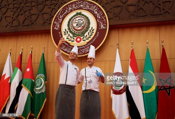 Cooks take a selfie at the Arab League summit in the Jordanian Dead Sea resort of Sweimeh on March 29 2017 Arab leaders are set to meet in Jordan for...