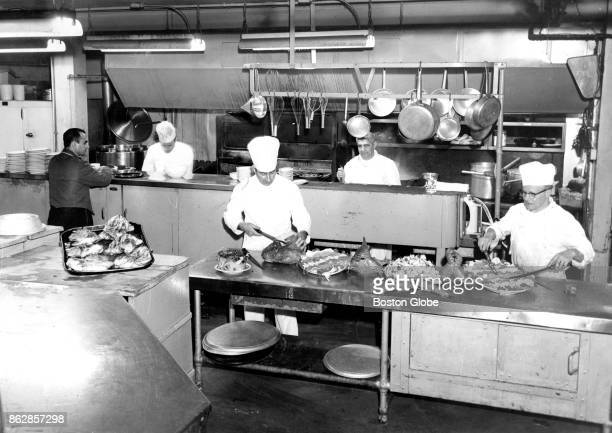Cooks work in the kitchen of the Boston Club at 46 Beacon St in Boston on Dec 4 1958 The building is the former home of Eben Jordan and was later the...