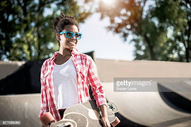 Cool African-American teenage girl in skate park