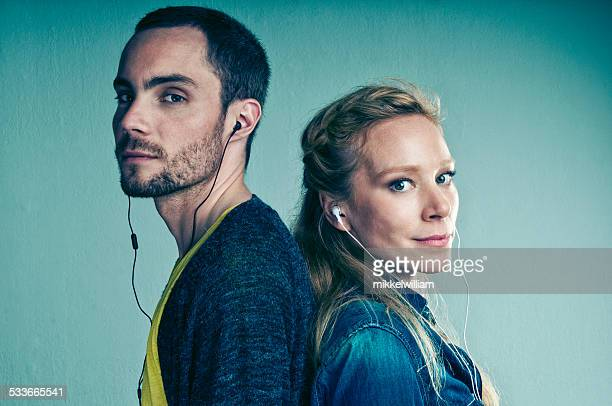 Cool couple listens to music in headphone