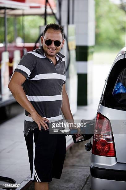 Cool cuban man filling the fuel