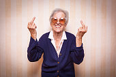 cool elder lady making middle finger sign