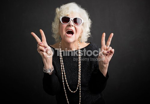 Cool grandmother showing peace sign : Stock Photo