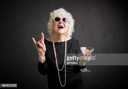 Cool grandmother with sunglasses and drink in hand : Foto de stock