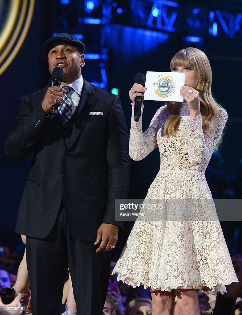 <a gi-track='captionPersonalityLinkClicked' href=/galleries/search?phrase=LL+Cool+J&family=editorial&specificpeople=201567 ng-click='$event.stopPropagation()'>LL Cool J</a> and <a gi-track='captionPersonalityLinkClicked' href=/galleries/search?phrase=Taylor+Swift&family=editorial&specificpeople=619504 ng-click='$event.stopPropagation()'>Taylor Swift</a> speak onstage at The GRAMMY Nominations Concert Live!! held at Bridgestone Arena on December 5, 2012 in Nashville, Tennessee.