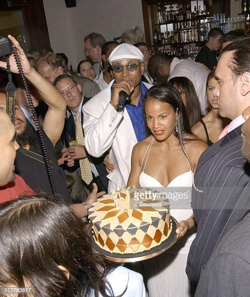 LL Cool J leads party goers in wishing Happy Birthday as Erica Reid presents the birthday to Antonio 'LA' Reid