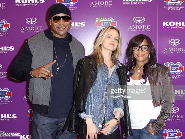LL Cool J Mena Suvari and Simone I Smith attend Amore by Simone I Smith Collection Debut at Kohl's on October 26 2013 in Los Angeles California