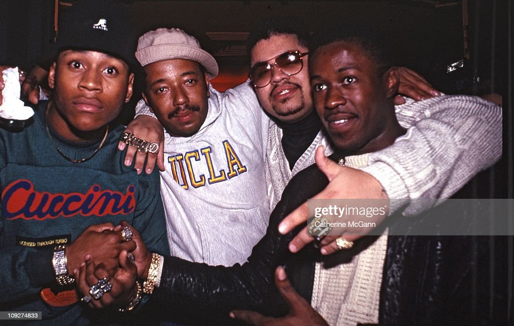 Cool J Russell Simmons Heavy D and unidentified pose for a photo at a party for the release of Run DMC's album 'Tougher Than Leather' on September 15...