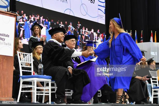 Cool J shakes a graduate's hand onstage during The Fashion Institute of Technology's 2017 Commencement Ceremony at Arthur Ashe Stadium on May 25 2017...