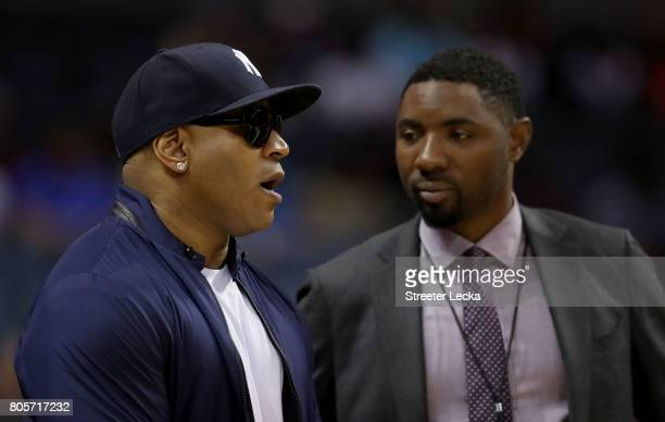 Cool J talks with Roger Mason Jr before week two of the BIG3 three on three basketball league at Spectrum Center on July 2 2017 in Charlotte North...
