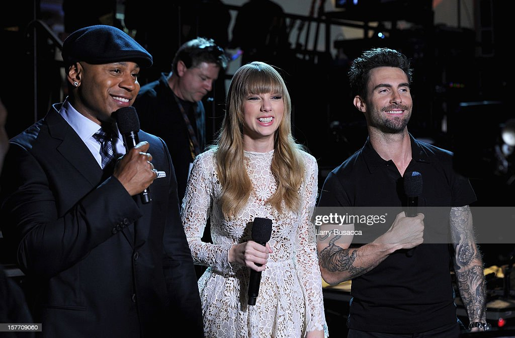 LL Cool J, Taylor Swift, and Adam Levine of Maroon 5 speak onstage at The GRAMMY Nominations Concert Live!! held at Bridgestone Arena on December 5, 2012 in Nashville, Tennessee.