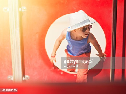 Cool little boy at the playground