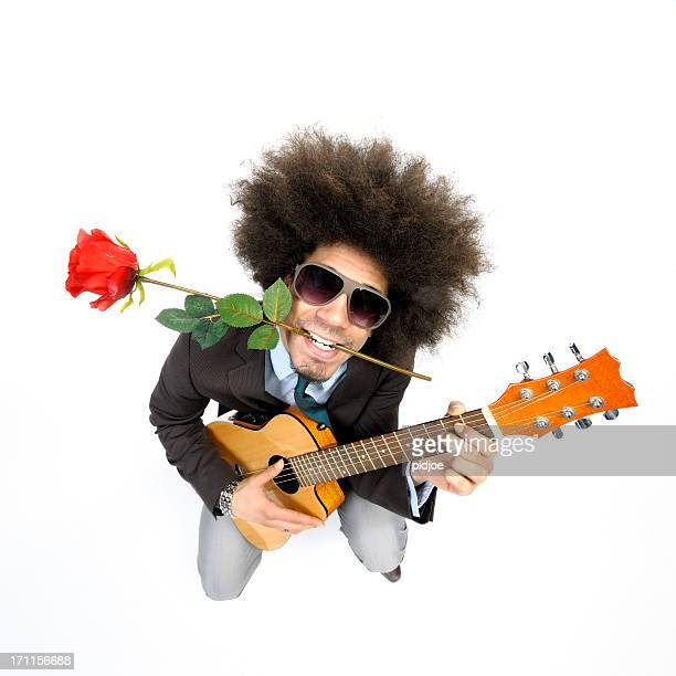 cool man playing love serenade on guitar