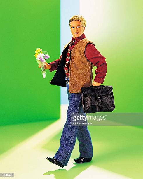 A 1999 Cool Shave Ken doll holds flowers and a briefcase in this studio portrait On March 13 Mattel toy company celebrated the 40th anniversary of...