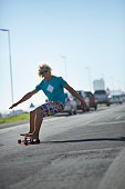 Cool skater carving on longboard