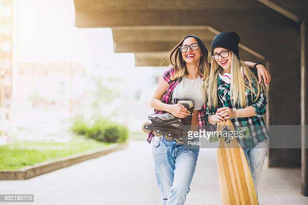 Cool teenage longboarders smiling and talking