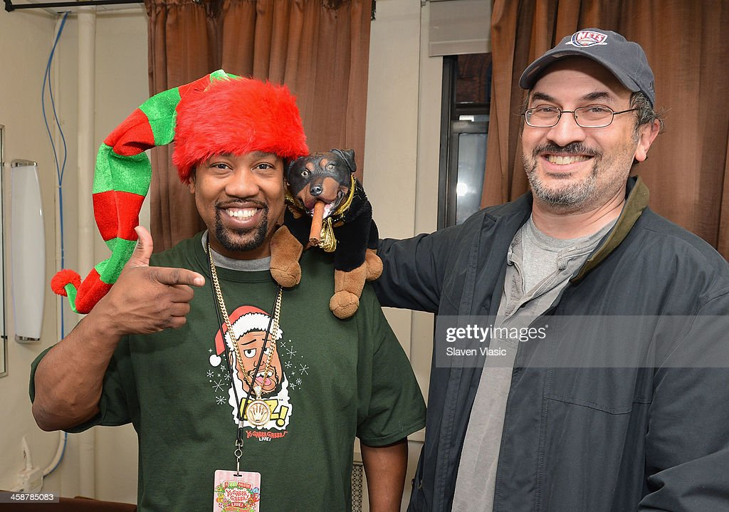 DJ Cool V (L) and Robert Smigel, voice behind Triumph, the Insult Comic Dog attend 'Yo Gabba Gabba! Live!' at The Beacon Theatre on December 21, 2013 in New York City.