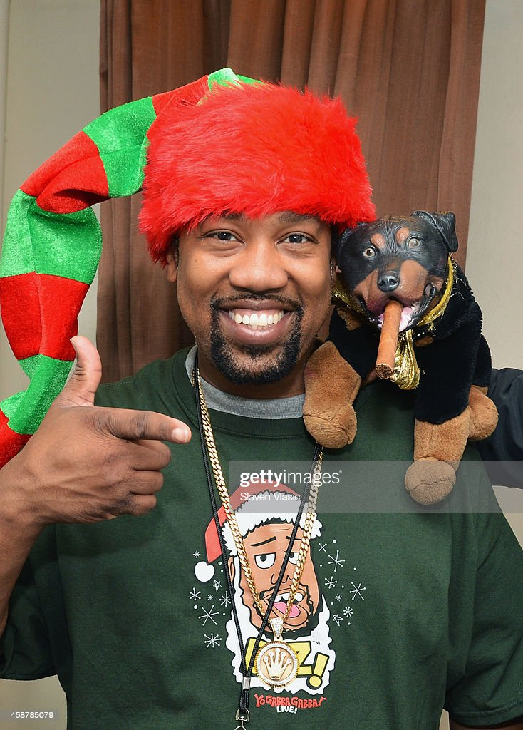 DJ Cool V and Triumph, the Insult Comic Dog attend 'Yo Gabba Gabba! Live!' at The Beacon Theatre on December 21, 2013 in New York City.