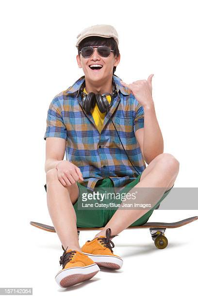 Cool young man with skateboard