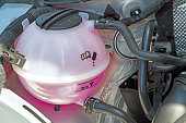 Coolant Tank with pink antifreeze in the engine