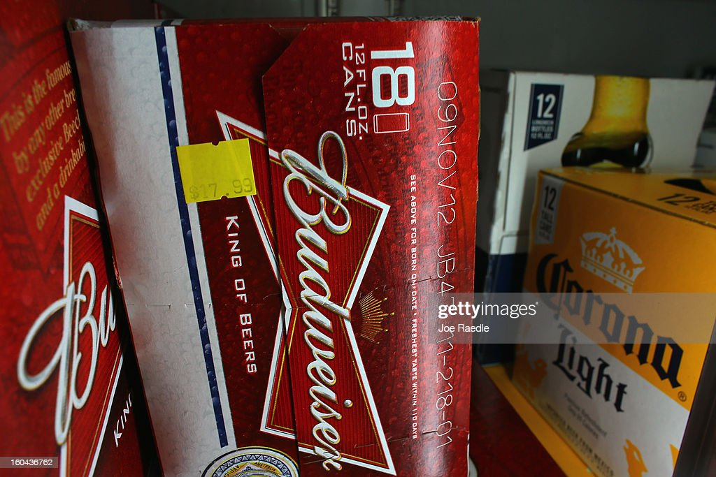 A cooler holds Anheuser-Busch's Budweiser and Grupo Modelo's Corona Light beers at the Chandi Wine and spirits store on January 31, 2013 in Miami, Florida. Federal authorities today filed a lawsuit to stop the Anheuser-Busch InBev's $20.1 billion takeover of Grupo Modelo.