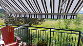 Awning over deck. Cool in the Summer heat.