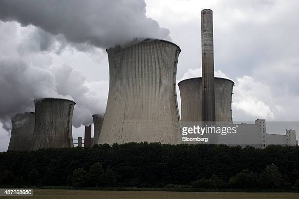 Cooling towers emit vapor at Neurath power plant operated by RWE AG in Grevenbroich Germany on Monday 7 Sept 2015 German utilities including RWE...