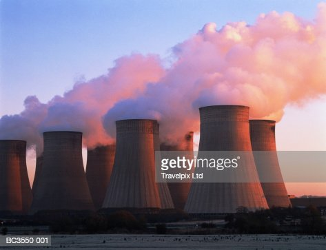 Cooling towers of coal-fired power station, dawn, England : Stock Photo