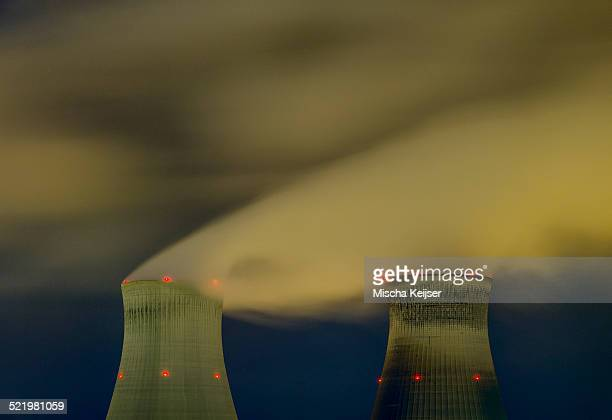 Cooling towers of the Doel nuclear reactor near Antwerp harbour at night , Antwerp, Belgium