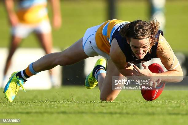 Cooper Barber of the Pioneers attempts to mark the ball during the round seven TAC Cup match between the Eastern Ranges and the Bendigo Pioneers at...