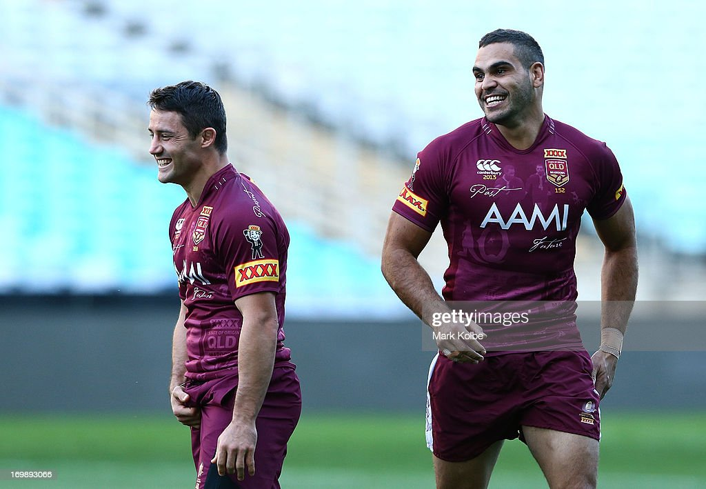 Cooper Cronk and Greg Inglis smile during a Queensland Maroons state of origin training session at ANZ Stadium on June 4, 2013 in Sydney, Australia.