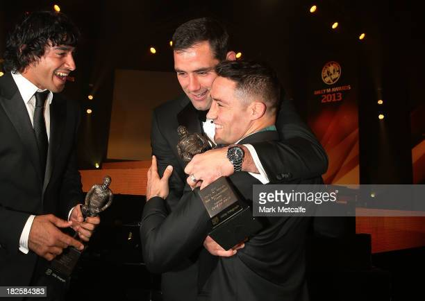 Cooper Cronk is congratulated by Cameron Smith and Johnathan Thurston after winning the Dally M Medal during the 2013 Dally M Awards at Star City on...