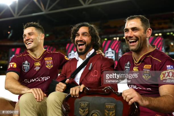 Cooper Cronk Johnathan Thurston and Cameron Smith of the Maroons pose with the State of Origin Trophy and celebrate winning the series game three of...