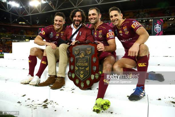 Cooper Cronk Johnathan Thurston Cameron Smith and Billy Slater of the Maroons pose with the State of Origin Trophy and celebrate winning the series...