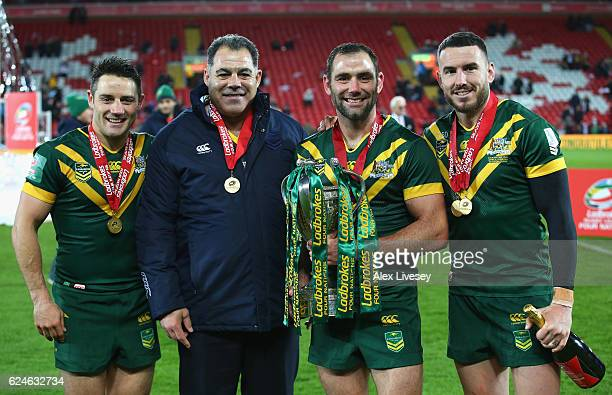 Cooper Cronk Mal Meninga Coach of Australia Cameron Smith and Darius Boyd of Australia celebrate with the trophy after victory in the Four Nations...