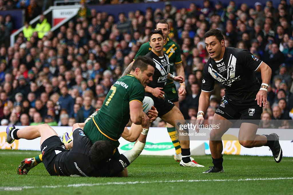 Cooper Cronk of Australia scores his sides second try as Kevin Locke and Dean Whare of New Zealand fail to challenge during the Rugby League World...