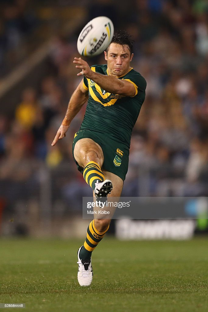 <a gi-track='captionPersonalityLinkClicked' href=/galleries/search?phrase=Cooper+Cronk&family=editorial&specificpeople=234620 ng-click='$event.stopPropagation()'>Cooper Cronk</a> of the Kanagroos kicks during the International Rugby League Trans Tasman Test match between the Australian Kangaroos and the New Zealand Kiwis at Hunter Stadium on May 6, 2016 in Newcastle, Australia.