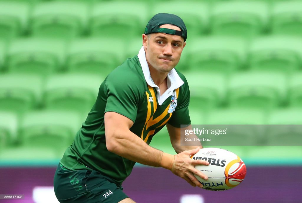 Cooper Cronk of the Kangaroos runs with the ball during an Australian Kangaroos training session on October 26, 2017 in Melbourne, Australia.