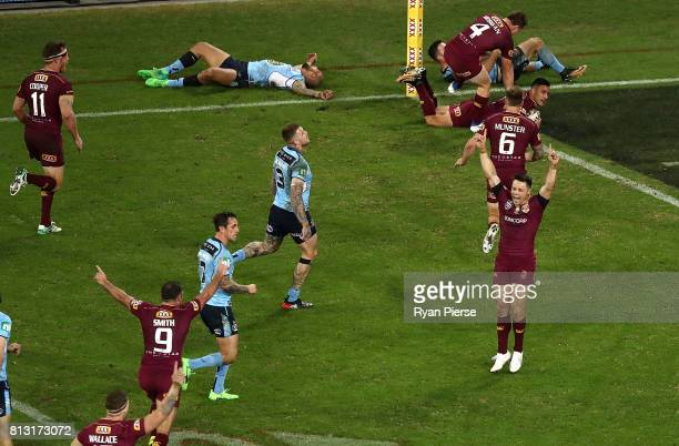 Cooper Cronk of the Maroons celebrates after Valentine Homes of the Maroons scored a try during game three of the State Of Origin series between the...