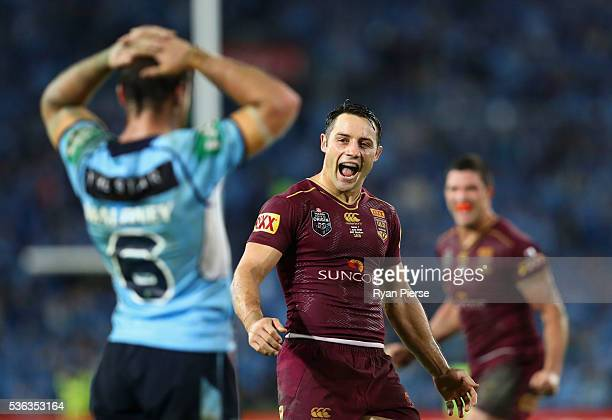 Cooper Cronk of the Maroons celebrates victory after game one of the State Of Origin series between the New South Wales Blues and the Queensland...
