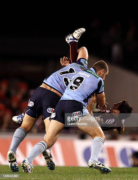 Cooper Cronk of the Maroons is dumped in a tackle during game one of the ARL State of Origin series between the Queensland Maroons and the New South...