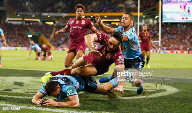 Cooper Cronk of the Maroons knocks the ball dead during game one of the State Of Origin series between the Queensland Maroons and the New South Wales...