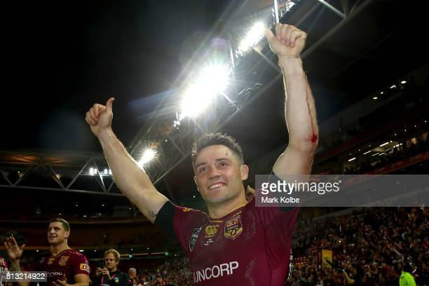 Cooper Cronk of the Maroons waves to the crowd as he celebrates victory after game three of the State Of Origin series between the Queensland Maroons...