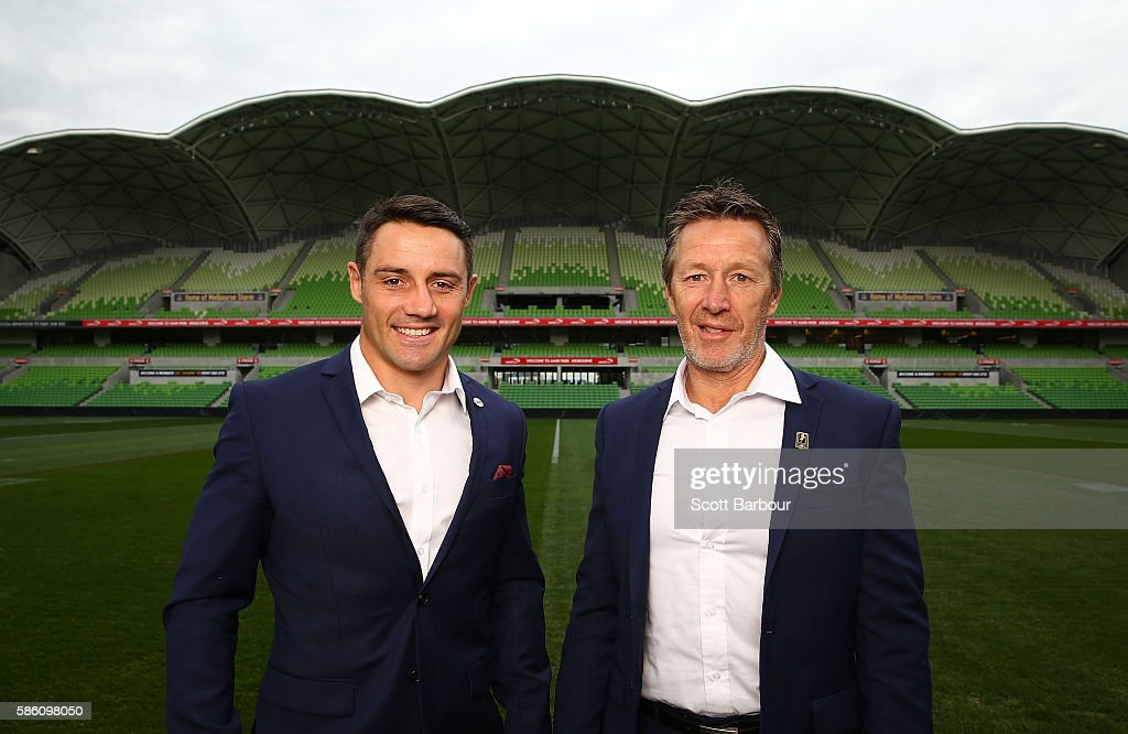 Cooper Cronk (L) of the Storm and Storm head coach Craig Bellamy pose during a Melbourne Storm NRL media opportunity at AAMI Park on August 5, 2016 in Melbourne, Australia. Cronk re-signed with the Storm until the end of 2018.