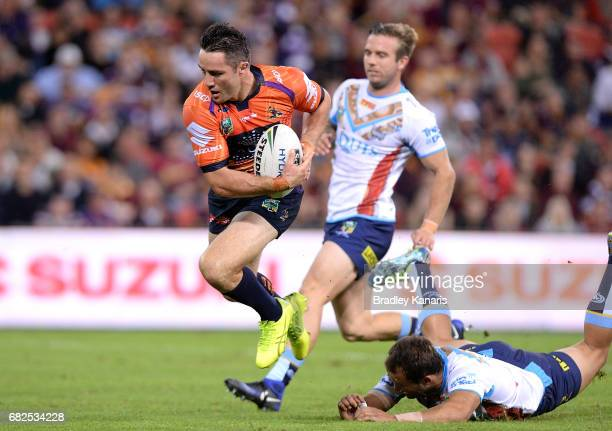 Cooper Cronk of the Storm breaks away from the defence during the round 10 NRL match between the Melbourne Storm and the Gold Coast Titans at Suncorp...