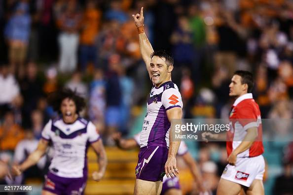 Cooper Cronk of the Storm celebrates kicking a field goal to win the match in golden point extra time during the round seven NRL match between the...