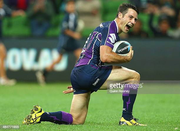 Cooper Cronk of the Storm celebrates scoring a try during the round 6 NRL match between the Melbourne Storm and the St George Illawarra Dragons at...