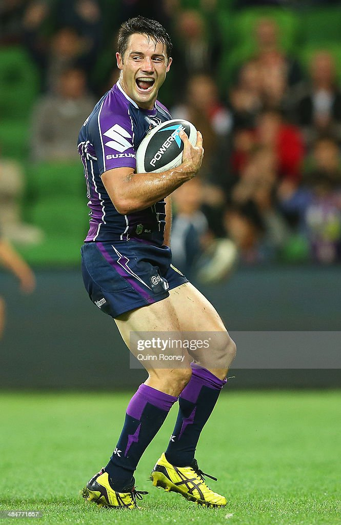 Cooper Cronk of the Storm celebrates scoring a try during the round 6 NRL match between the Melbourne Storm and the St George Illawarra Dragons at AAMI Park on April 14, 2014 in Melbourne, Australia.
