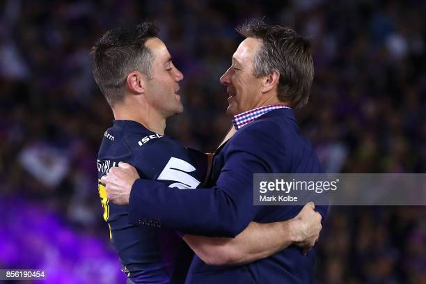 Cooper Cronk of the Storm celebrates with coach Craig Bellamy after winning the 2017 NRL Grand Final match between the Melbourne Storm and the North...