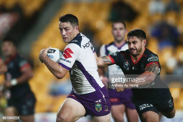 Cooper Cronk of the Storm fends off Shaun Johnson of the Warriors during the round two NRL match between the New Zealand Warriors and the Melbourne...